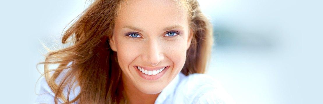model smiling into camera