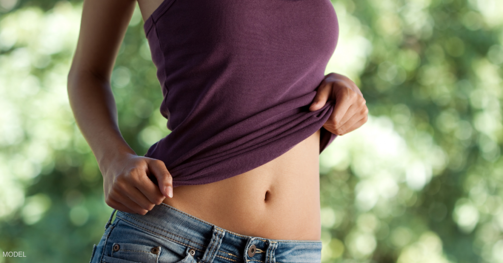Portrait of a flat stomach after having a tummy tuck by a board certified plastic surgeon in Eugene, OR