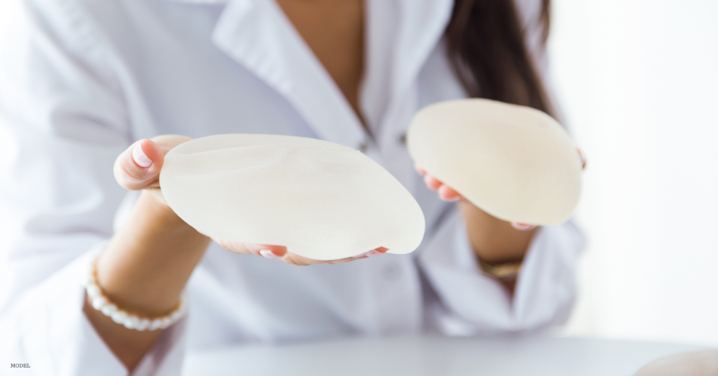 Doctor in Eugene, OR holding breast implants to explain safety